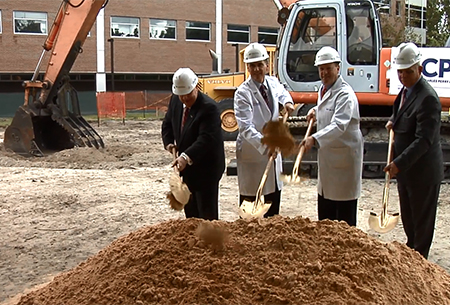 This video screenshot shows leaders from the University of Florida and others breaking ground on the new George T. Harrell Medical Education Building  Friday, Nov. 22, 2013. From left to right: Darrell Kirch, M.D., Association of American Medical Colleges president; Michael L. Good, M.D., UF College of Medicine dean; David S. Guzick, UF Health president; and Bernie Machen, Ph.D., University of Florida president.