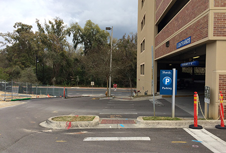 Please yield to pedestrians in the crosswalk at the parking garage entrance/exit.