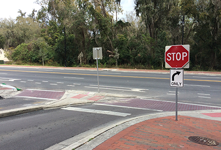 By law, turning left onto SW 13th Street/state Road 441 from the south campus parking garage exit is prohibited.