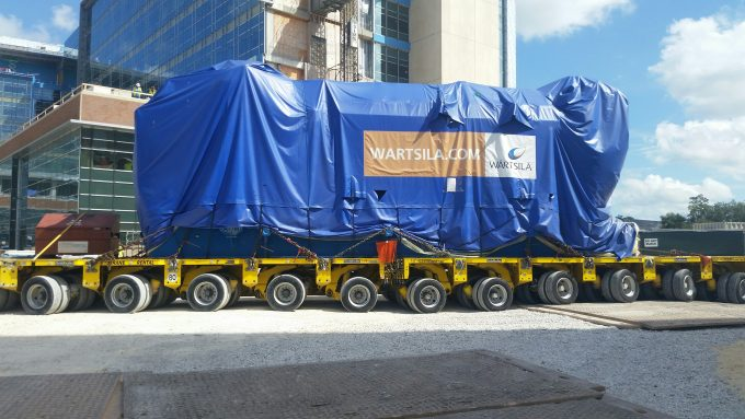The 270,000 pound generator is wheeled onto UF Health's south campus.