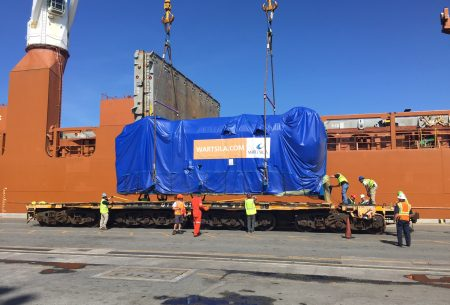 The 10,000-horsepower generator is loaded onto a train car in Jacksonville.